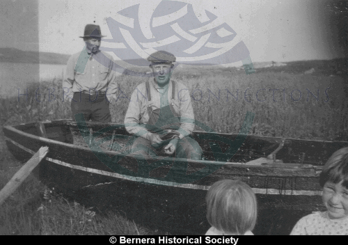 Earshader village group with boat
