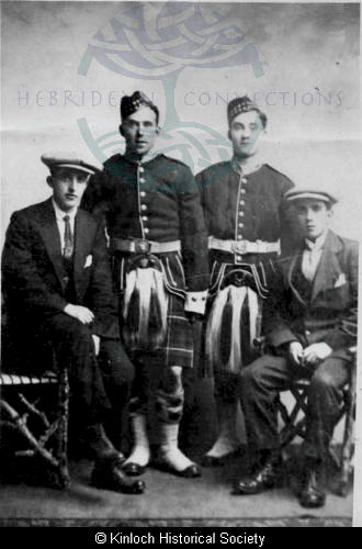 Studio portrait of four young men from Kinloch